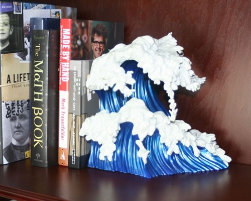 http-::www.worldsstrangest.com:neatorama:uprisings-bookend-inspired-by-the-great-wave-off-kanagawa: